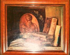 Livres et petit médaillon en bois